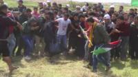 Protesters at the Israel-Gaza border
