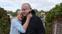 Ukrainian solders are reunited with their families in the largest exchange of prisoners with pro-Russia rebels since the conflict started in April 2014.