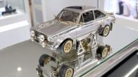 Bejewelled miniature replica Escort car