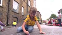 Boy playing in the street