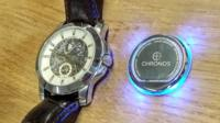 Chronos pad next to a watch