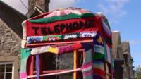 Phone box covered in knitting