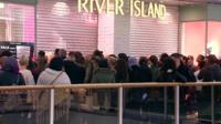 Shoppers outside River Island at Brent Cross