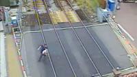 Man on level crossing