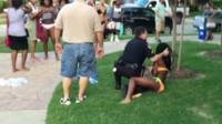 police officer pushes teenage girl to ground