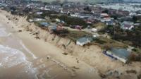 Aerial view of Hemsby homes on cliff
