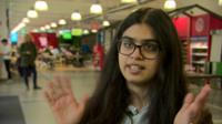 The SU's access officer demonstrates British Sign Language applause