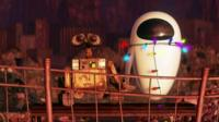 A scene from Wall-E - Wall-E and Eve hold hands