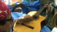 Jazz musician Musa Manzini was kept awake for part of his surgery to have a tumour removed.