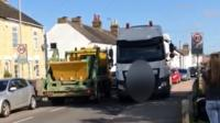 Lorry mounting pavement in Arlesey in Bedfordshire