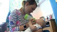 Leah feeding her baby