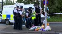 Police lay flowers at scene