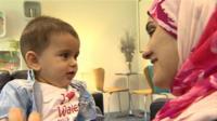Asmaa Al Fashtaki and baby son