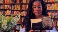 Tomi Adeyemi reading her book