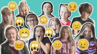 Children making emoji faces