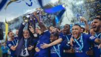 Leicester captain Wes Morgan and manager Claudio Ranieri lift the Premier League trophy