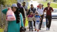 Migrants walk on the Croatian side of the Slovenska vas-Bregana border crossing between Croatia and Slovenia