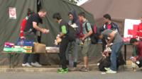 Migrants queuing for food and water at the Nickelsdorf crossing near Vienna.