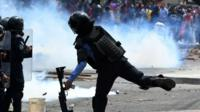 Protesters and riot police clash in Honduras
