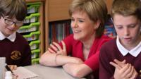 First Minister Nicola Sturgeon sits with school children