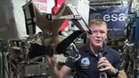 Tim Peake holds harness