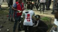 Medics attend to an injured person