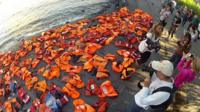 Life jackets laid out alongside New York's watershore