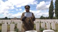 A serviceman reads out the name of a man who was killed in the Passchendaele battle