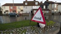 Flood warning sign on a flooded street