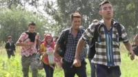 Migrants rush for the border