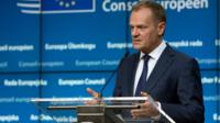 European Council President Donald Tusk speaks during a media conference at an EU summit in Brussels on Friday, Feb. 19, 2016.
