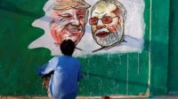 President Trump and PM Modi's face painted on a wall