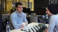 Magnus Carlsen with Mike Corey