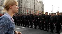 Maria Baronova confronting riot police in 2012
