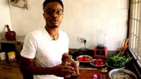 Nigerian chef Michael Elegbede with stockfish, tomatoes, peppers and other ingredients for efo riro