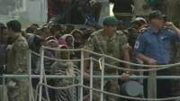 Naval force officers on migrant ship from Libya