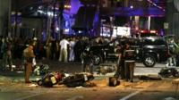 Motorcycles lie on the street at the scene of a bomb attack near Erawan Shrine, central Bangkok, Thailand