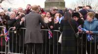 Crowds gathered ahead of a visit by Prince Harry and Meghan Markle to Edinburgh.
