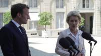 Ursula von der Leyen stands next to Emmanuel Macron