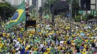 Protesters dressed in the colours of the Brazilian flag