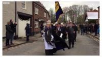 Silhouettes are paraded through Tarporley