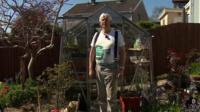 Terry Walton by his greenhouse