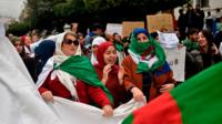 Algerian protesters demonstrate against their ailing president's bid for a fifth term in power, in Algiers on 8 March 2019