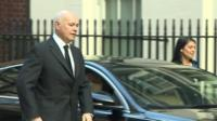 Iain Duncan Smith by a car