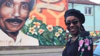 Judy Evans in front of her father's mural