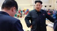 North Korean leader Kim Jong-Un visiting a farm machine exhibition