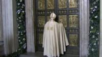 Pope Francis at the bronze door
