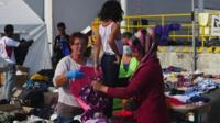 Migrants receive donated clothes