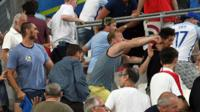 Supporters clash in the stands at Stade Velodrome in Marseille