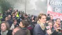 Workers boo as Emmanuel Macron arrives at the Whirlpool factory in Amiens, 26 April